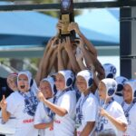 The 12-and-under boys' A team for the Del Mar Water Polo Club lifts it gold-medal trophy high after the big win at USA Water Polo Junior Olympics July 20.