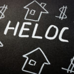 HELOC home equity line of credit loan and homes on the black sheet.