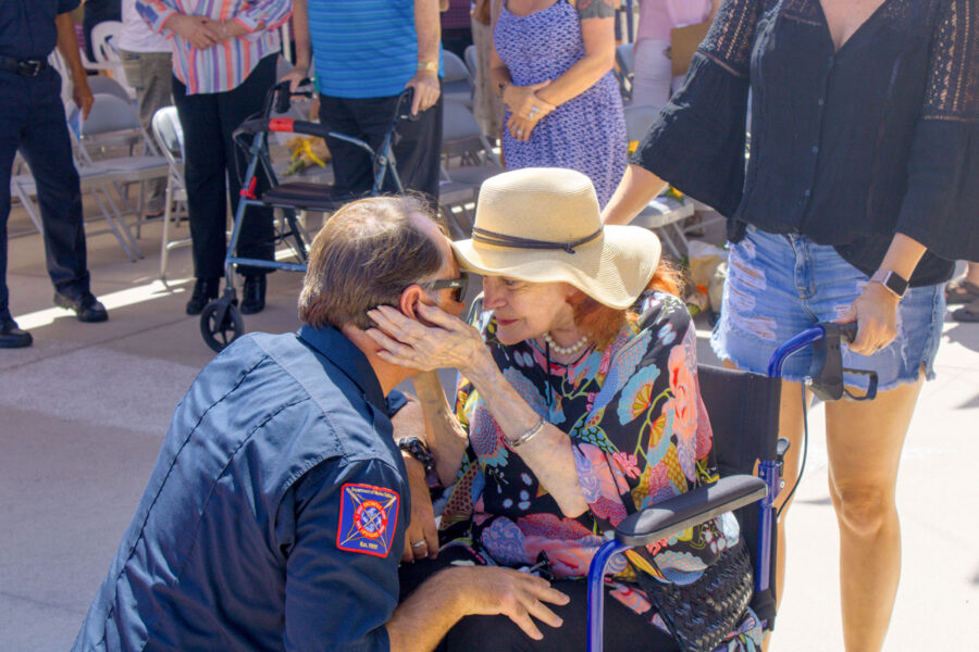 Capt. Larry Giles is embraced by his grandmother following Tuesday's farewell ceremony at Moonlight Beach