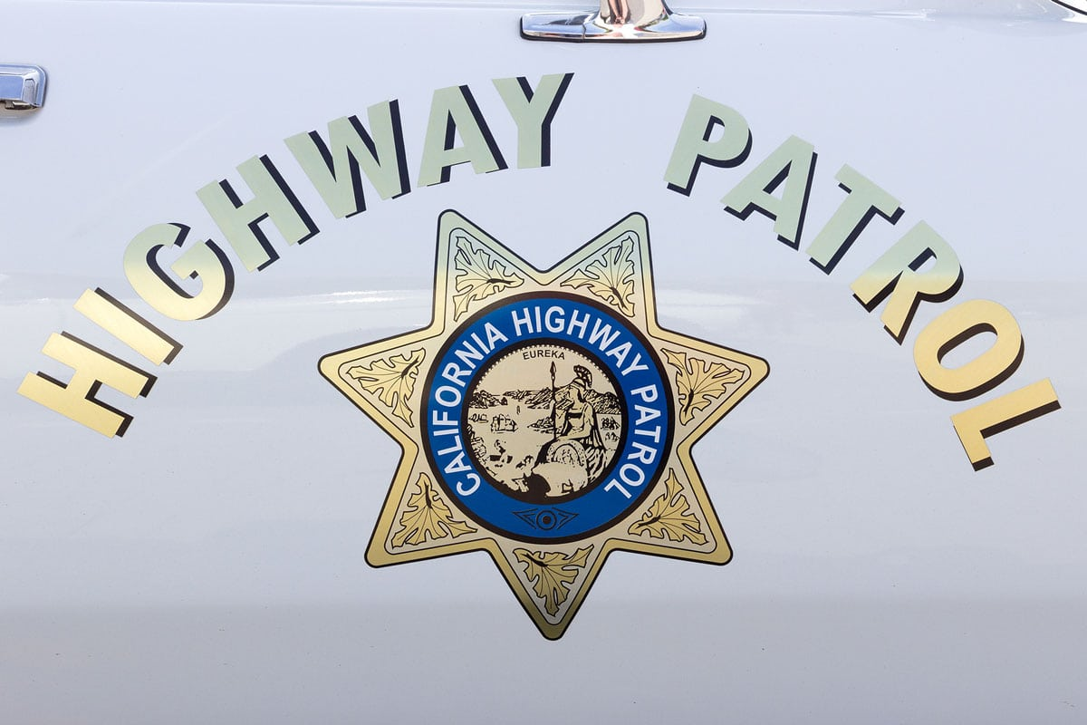 The officer was removing a traffic hazard from the freeway when he was struck. File photo