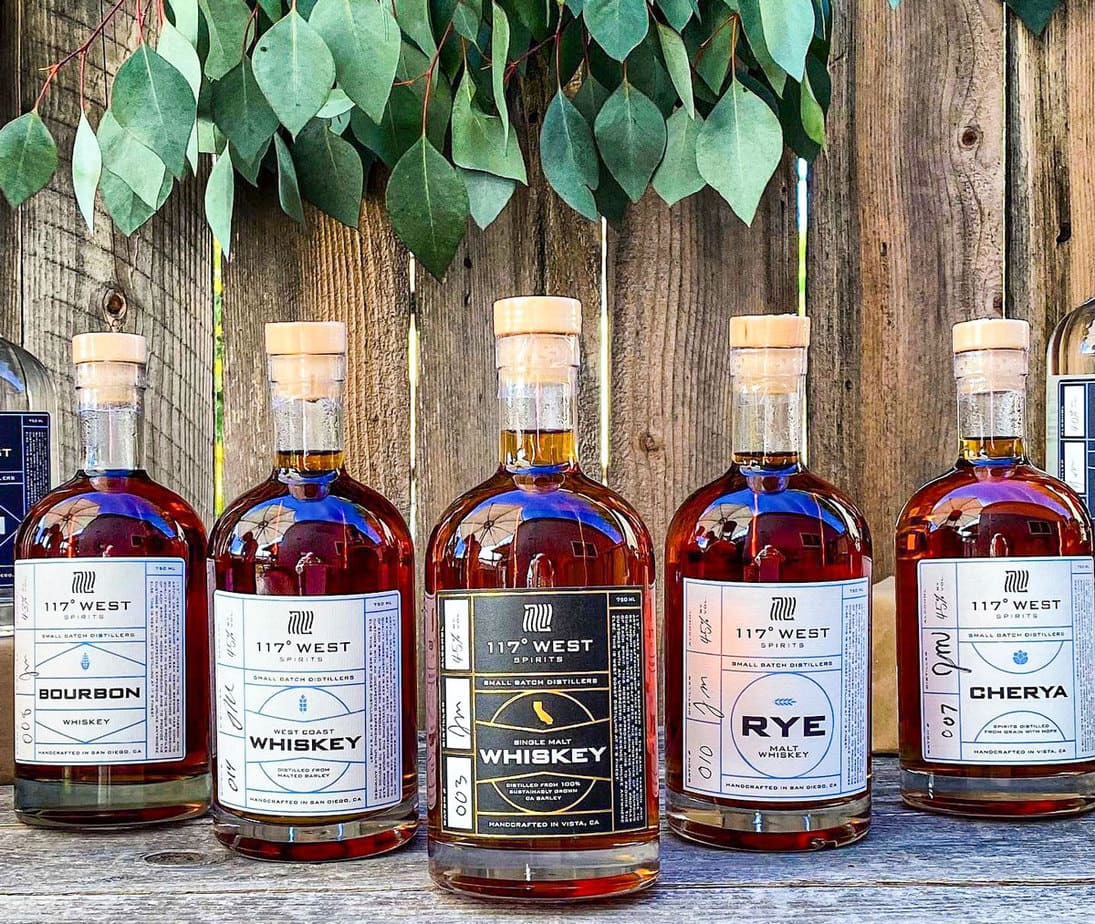 """A variety of liquors by 117° West Spirits, including, rye, bourbon and """"cherya,"""" which is short for cherry-wood smoked rye IPA and distilled from malted barley, cherry-wood smoked malt, crystal malt and rye. Photo via Facebook/117° West Spirits"""