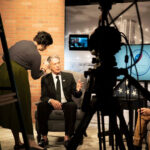 """Actor Jack Scalia hosts KOCT's """"Proud to Serve."""" The local public access television station is celebrating 40 years of providing public access programming in Oceanside. Photo via Facebook/KOCT"""