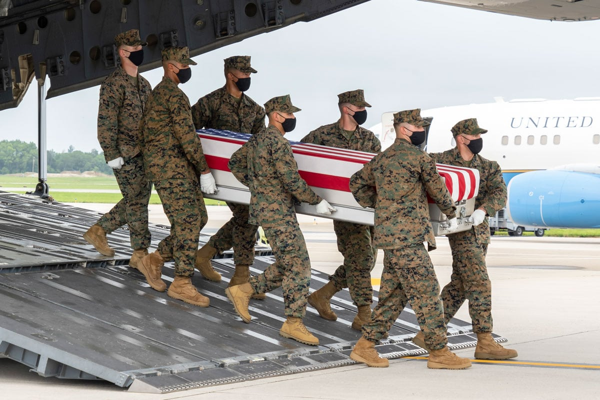 A U.S. Marine Corps carry team transfers the remains of Marine Corps Lance Cpl. Dylan R. Merola, of Rancho Cucamonga, on Aug. 29 at Dover Air Force Base in Delaware. Merola was assigned to Camp Pendleton. Photo by Jason Minto