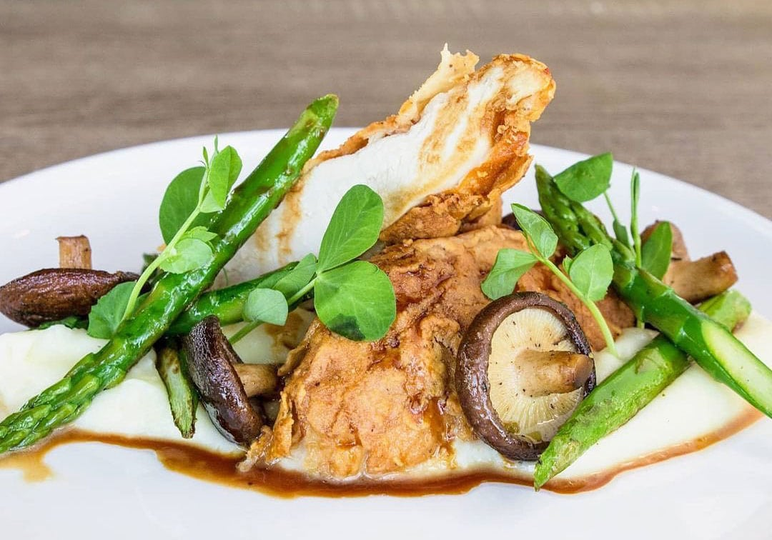 Mary's Crispy Chicken, inspired by chef James Augustine's mother, served potato purée, asparagus, shiitake mushrooms and chicken jus at J at SkyDeck in Del Mar. Photo via Facebook/J at SkyDeck
