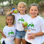 A trio of young volunteers, left to right, Emma Frandsen, Callie Marty and Kinleigh Frandsen, took part in the Green Apple Day of Service this past Saturday at Knob Hill Elementary School in San Marcos. Courtesy photo