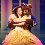 Jenna Lea Rosen and Michael Deni portray Beauty and the Beast in the production of the same name at Vista's Moonlight Amphitheatre. The popular Disney musical will play through August 7.