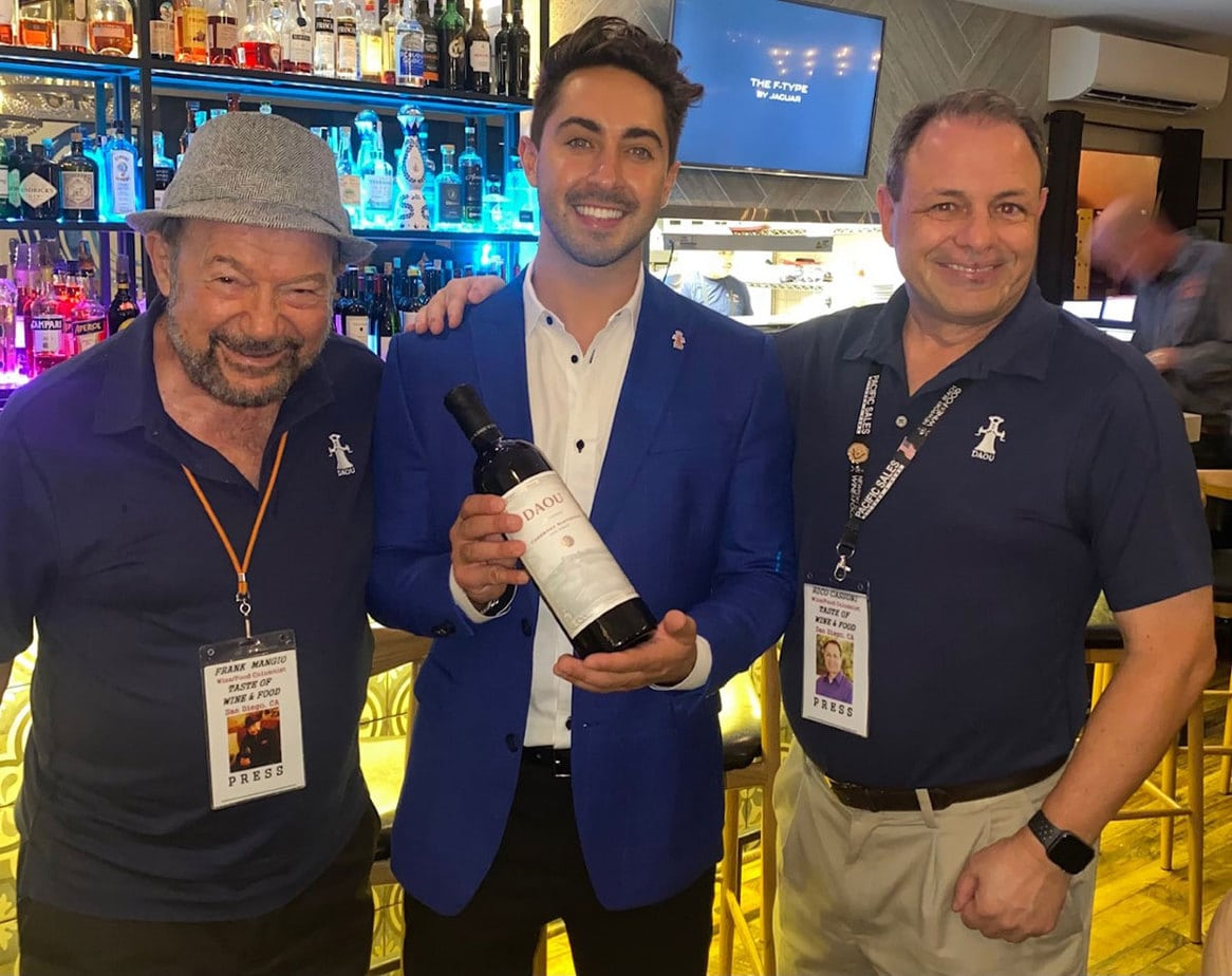 Left to right) Taste of Wine & Food's Frank Mangio (left) and Rico Cassoni (right) stand with Daou Family Estates representative Roman Palumbo. Courtesy photo