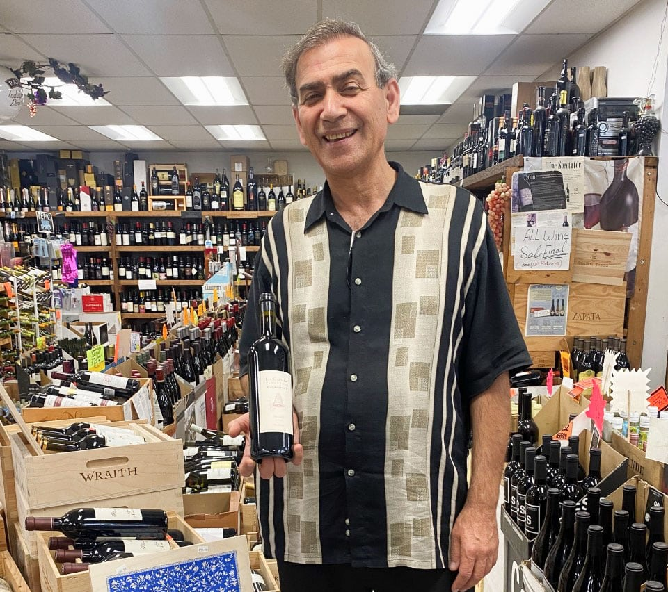 Nickolas Ramo, of Farr Better Spirits, holds a bottle of DAOU Vineyards' first production wine, 2005 La Capilla, standing next to Daou's premium 100-point Patrimony. Photo by Rico Cassoni