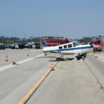 A small Piper aircraft was in the air for approximately nine minutes before making an emergency landing on Interstate 5 near Via de la Valle in del Mar. Photo courtesy of San Diego Fire Department