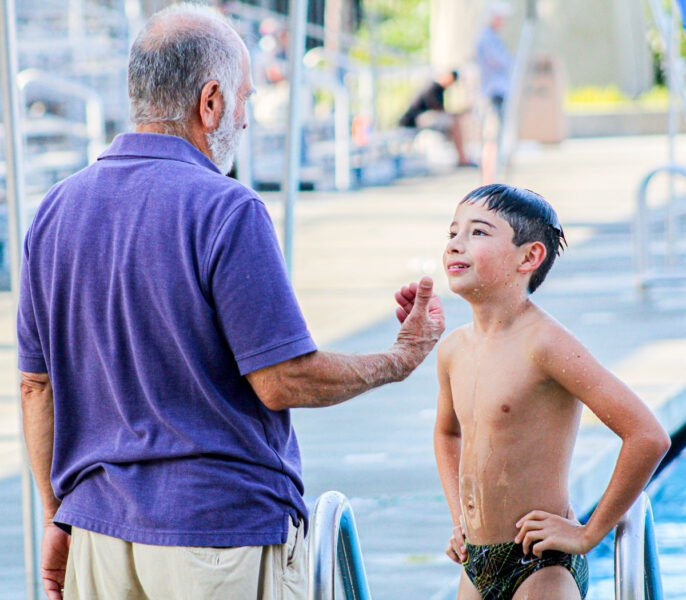 Logan Castaneda listens to feedback from diving coach Don Cashmore during practice on July 15 at Alga Norte Aquatic Center in Carlsbad