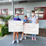 """Families and advocates for The Winston School hold signs during a """"Meet the Mayor"""" event on Aug. 30 in Del Mar. Courtesy photo"""