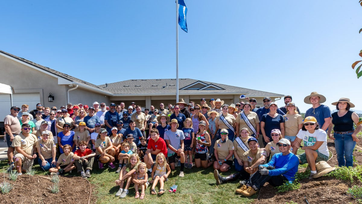 More than 250 volunteers participated in a volunteer day with Homes for Our Troops to complete adapted homes for two wounded Marine veterans. Photo courtesy of Homes for Our Troops
