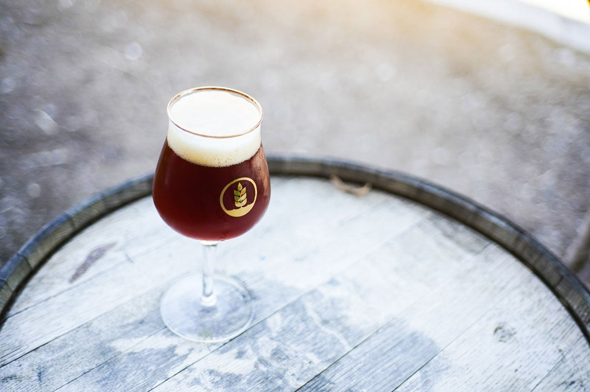 """Pure Project's """"New Fashioned,"""" an imperial sour red ale aged in bourbon barrels with organic cherries and orange peels. Photo via Facebook/Pure Project"""