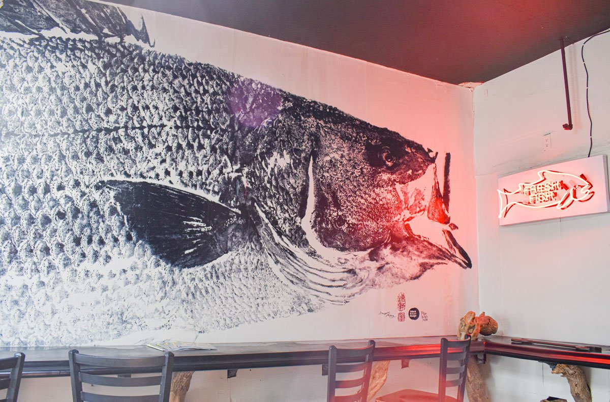 Wrench & Rodent Seabasstropub in Oceanside is now home to a unique piece of art: a giant gyotaku print of a locally caught sea bass created by artist Dwight Hwang.