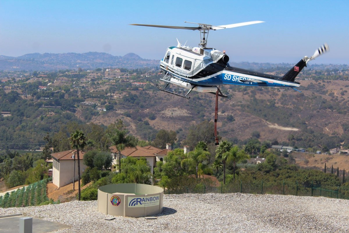 A San Diego County Sheriff's wildfire helicopter fills up with water at the new Rapid Aerial Water Supply on Sept. 14 in Fallbrook. Photo by Steve Puterski