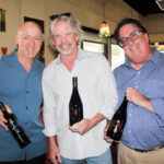 (From left to right) Victor Magalhaes, owner of Vittorio's Family Style Trattoria, Ted Plemons, Partner in Cass Vineyard and Winery and Jim Kern, Cass Representative showcase the latest Rockin' Ted wine. Photo by Frank Mangio