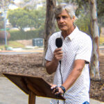 Duncan Brown, president of the San Dieguito Faculty Association, delivers comments on Saturday as the teachers union begins its effort to collect signatures for a recall of Trustee Michael Allman.