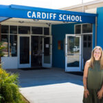 Michell Giroux stands in front of the Cardiff School a week before welcoming students back to the classroom from summer break. Photo by Bill Slane