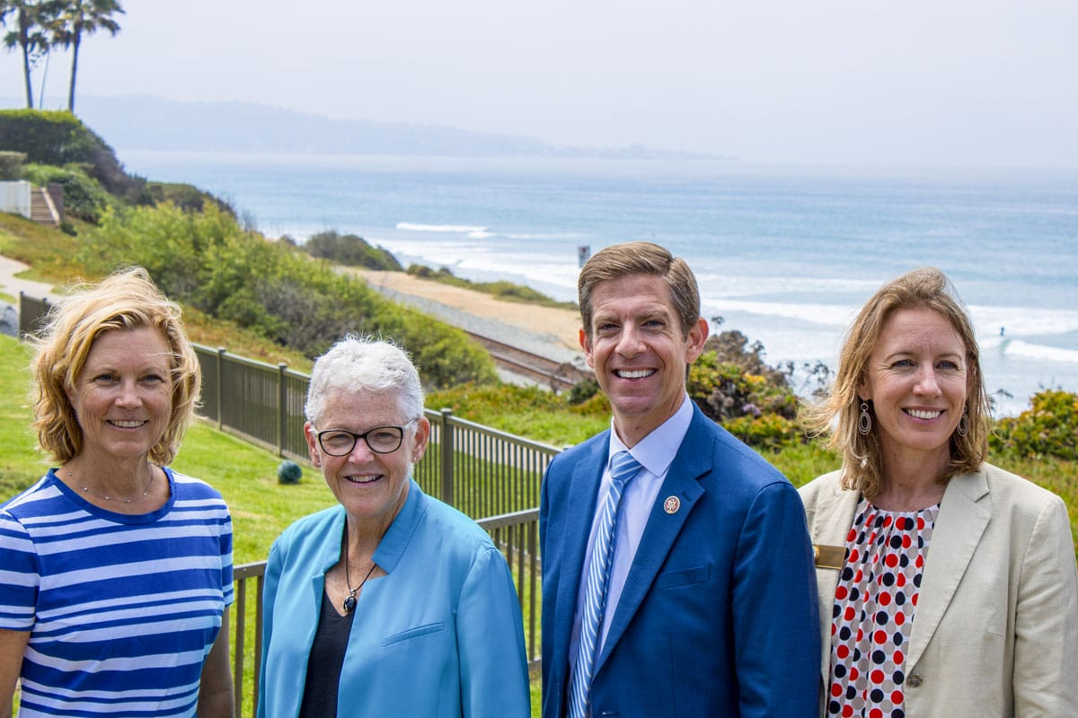 Pictured from left to right, Del Mar Mayor Terry Gaasterland, White House National Climate Advisor Gina McCarthy, Rep. Mike Levin and Encinitas Mayor Catherine Blakespear stop for a picture after a joint press conference Tuesday morning at Seagrove Park in Del Mar. Photo by bill Slane