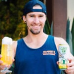 Anthony Tallman, owner and head brewer at Burgeon Beer Company in Carlsbad, offers you a fresh beer. Photo via Facebook/Burgeon Beer Co.