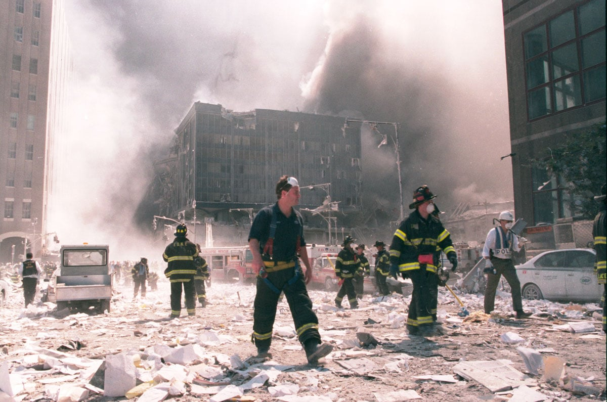 New York City firefighters work near the area known as Ground Zero after the collapse of the World Trade Center's twin towers on Sept. 11, 2001, in New York City. Photo by Anthony Correia