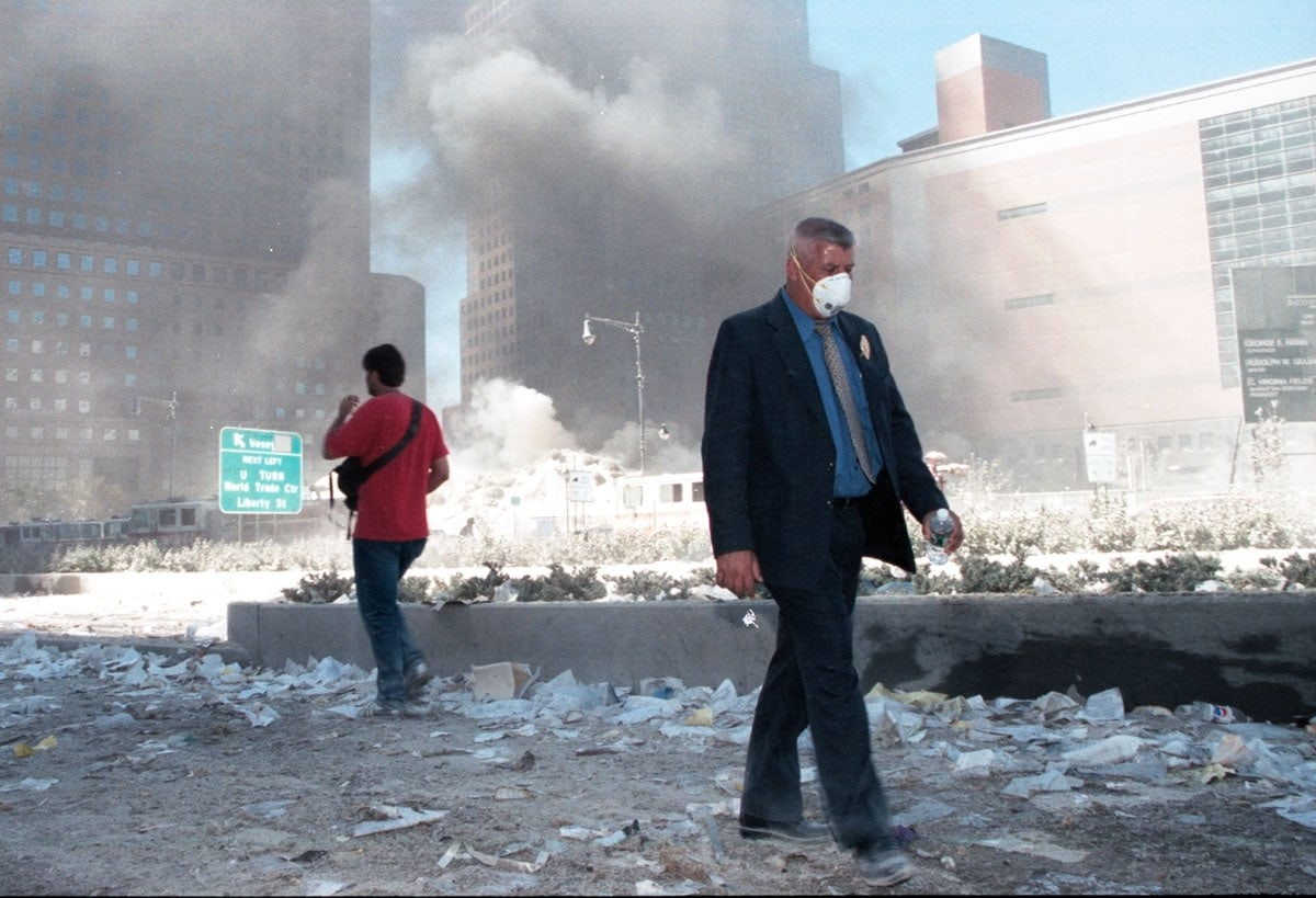 Pedestrians walk near ground zero shortly after the twin towers collapsed on Sept. 11, 2001, in New York City. Photo by Anthony Correia